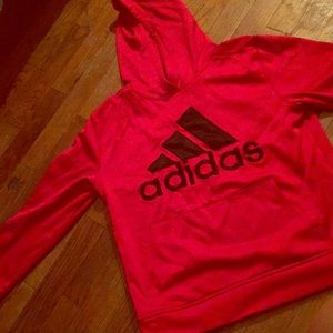 This is a red athletic adidas hoodie 😊
